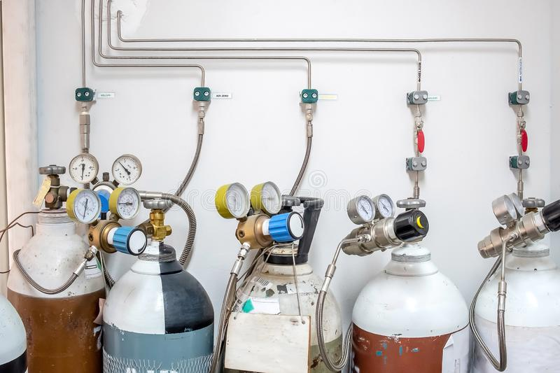 Valves of nitrogen, Helium, Oxygen  Air Zero tank and Gas Pressure Meter with Regulator for monitoring measure pressure stock photos