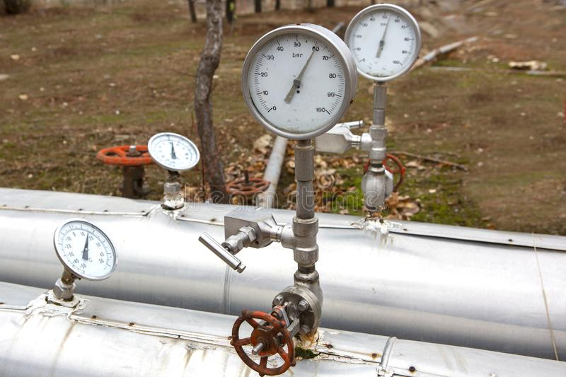 Different types of valves and indicators in the oil industry. Valves and pressure gauges for different types in petroleum industry stock photography