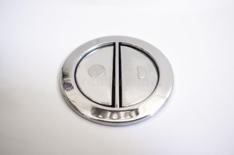 Valvola dello sciacquone doppia per la pulizia con due bottoni separati immagini stock