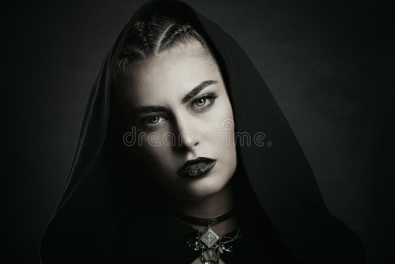 Vampire with beautiful green eyes stock photos