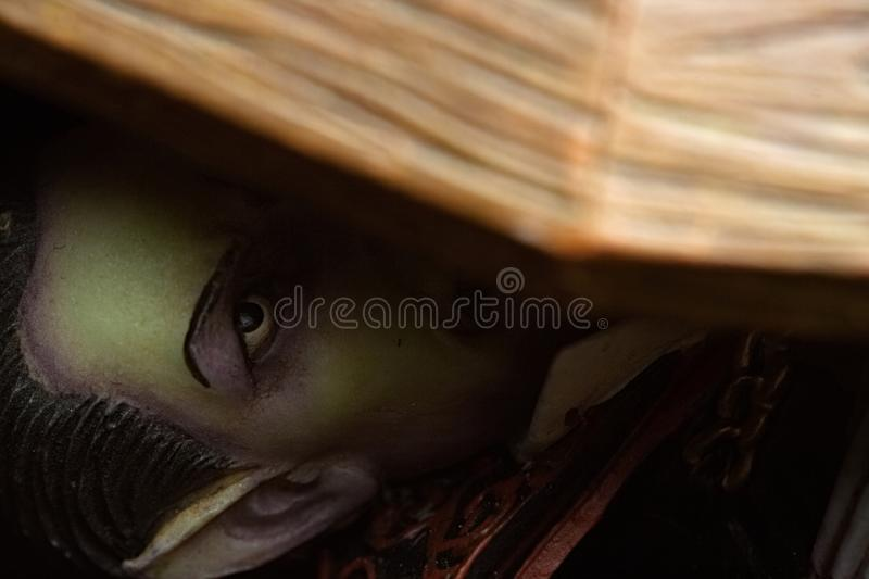 Vampire Hiding in Coffin From Sunlight. Vampire cowering from the light trying to get back into his coffin in time royalty free stock image