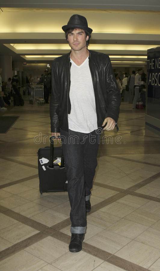 Vampire Diaries star Ian Somerhalder at LAX. LOS ANGELES - AUGUST 8TH: Vampire Diaries star Ian Somerhalder is seen at LAX . August 8th 2010 in Los Angeles stock photos