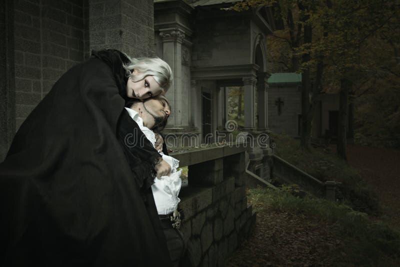 Vampire embrace royalty free stock photography