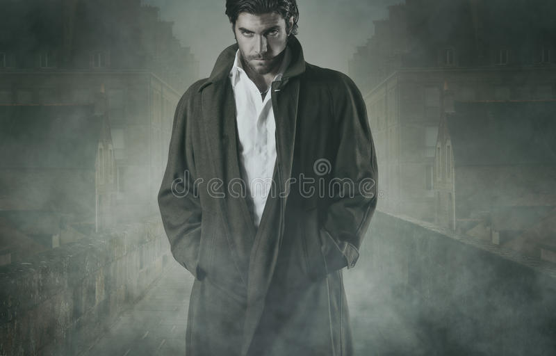 Vampire in the fog. Vampire is waiting in the fog of a walled city. Halloween and horror concept