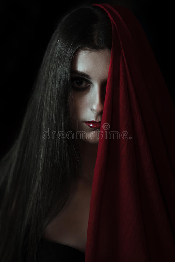 Vampire girl looking at the camera. Scary vampire girl stares into the camera royalty free stock photo