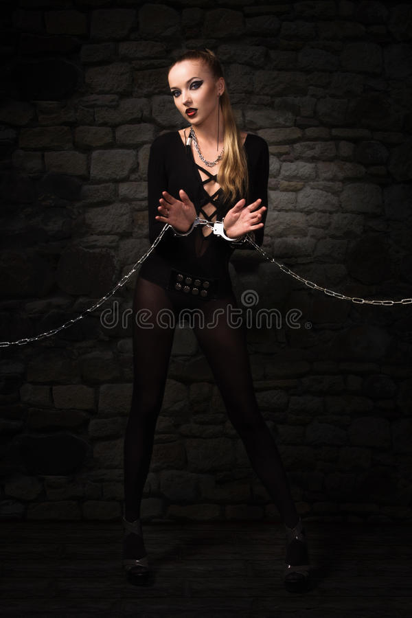 Vampire girl in a silver chains. Portrait of a vampire girl in a silver chains stock image