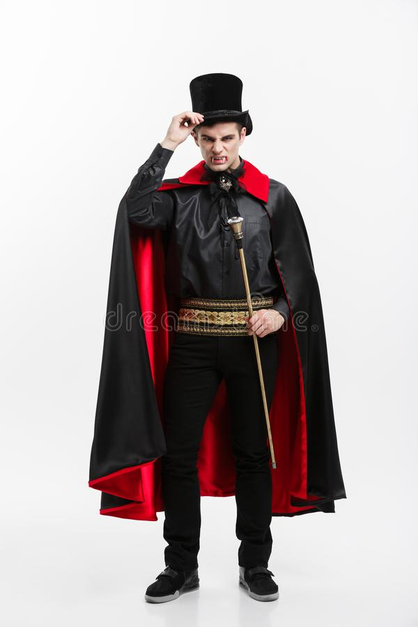 Vampire Halloween Concept - Full length Portrait of handsome caucasian Vampire in black and red halloween costume. royalty free stock images