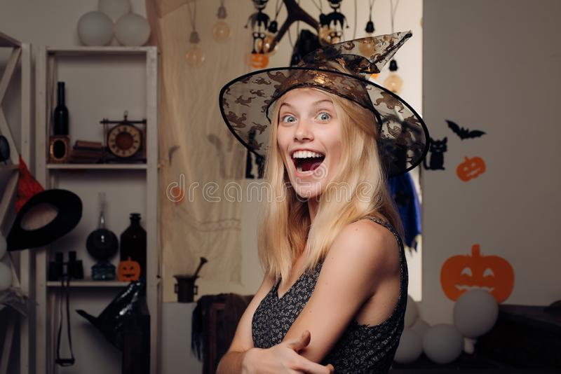Vampire Halloween Woman portrait. Funny expression. Having fun. Happy gothic young woman in witch halloween costume with stock image