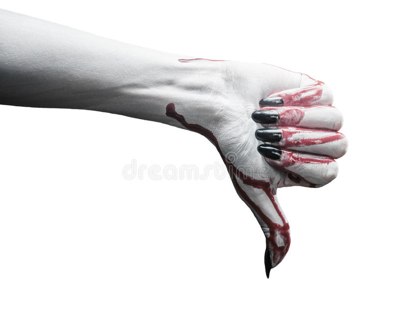 Vampire hand with thumb down gesture. Vampire hand in blood with thumb downgesture on white background. Halloween or horror theme stock photography