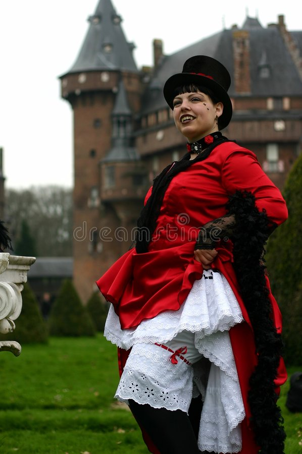 Vampire lady. A vampire lady showing her skirts stock photo