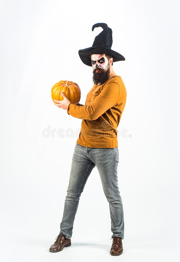 Vampire man with bloody eyes - full length. Evil vampire man. Halloween man with pumpkin. Celebrate Halloween in America royalty free stock photo