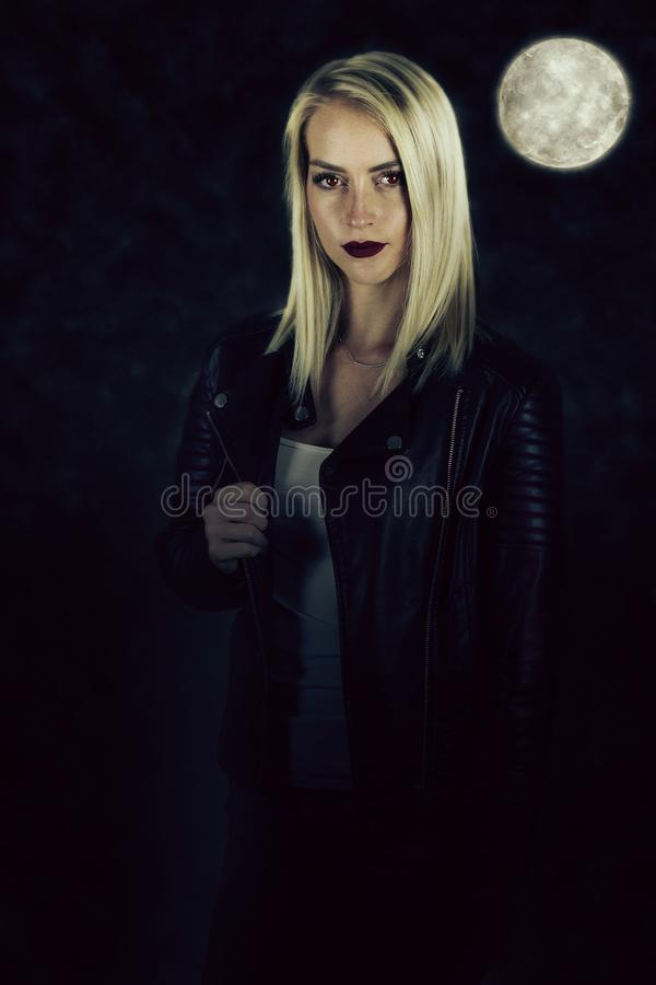 A vampire story. Beautiful woman wearing a leather jacket royalty free stock photography