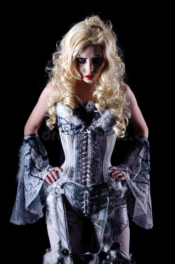 Vampire woman. Portrait of vampire woman with stage makeup isolated on black royalty free stock images
