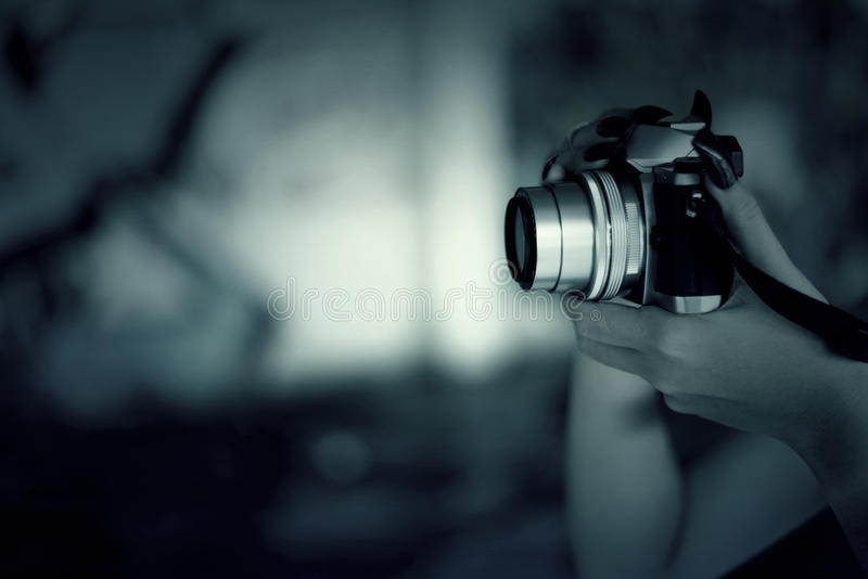 Vampires Woman with red nails and camera in hand. stock photo