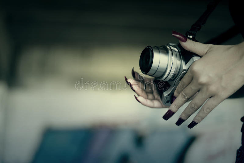 Vampires Woman with red nails and camera in hand. stock image