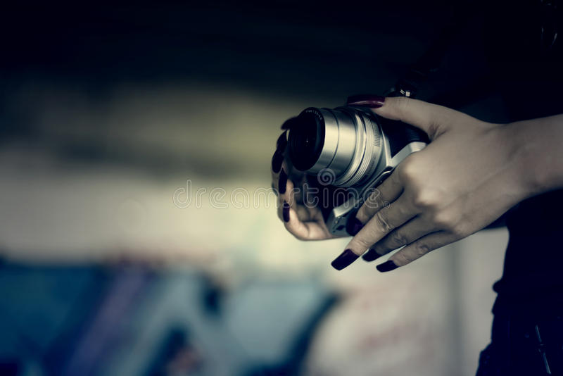 Vampires Woman with red nails and camera in hand. stock images
