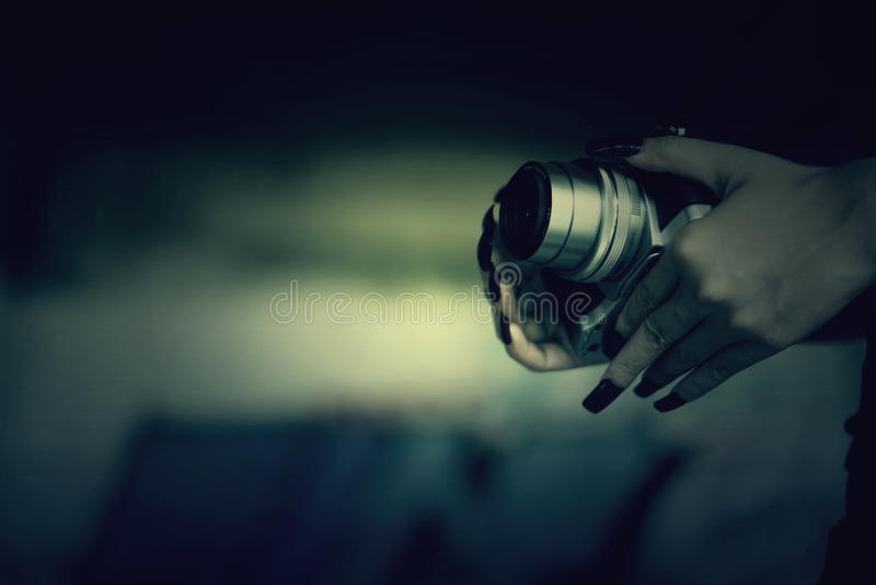 Vampires Woman with red nails and camera in hand. stock photos