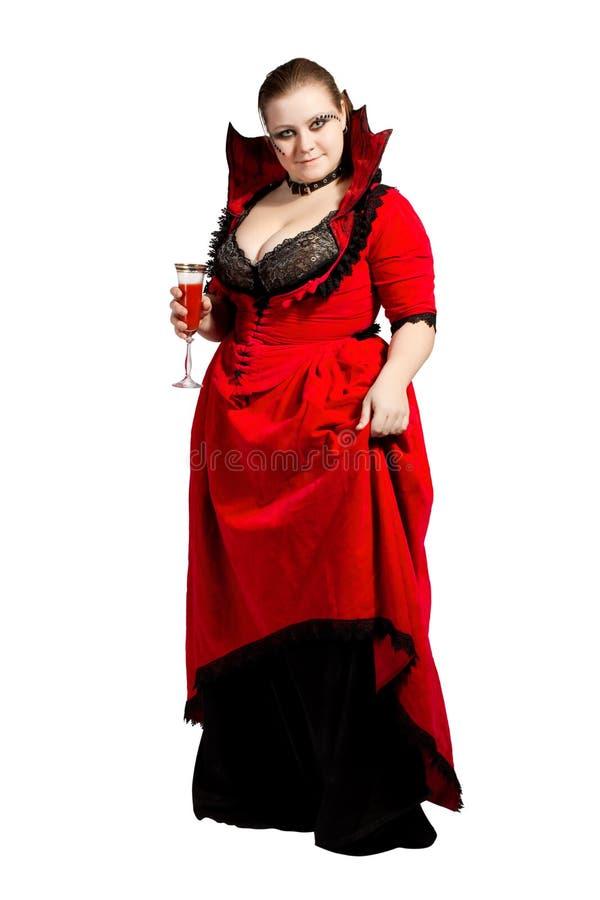Vampiro isolado no vestido vermelho do parte-colar fotografia de stock