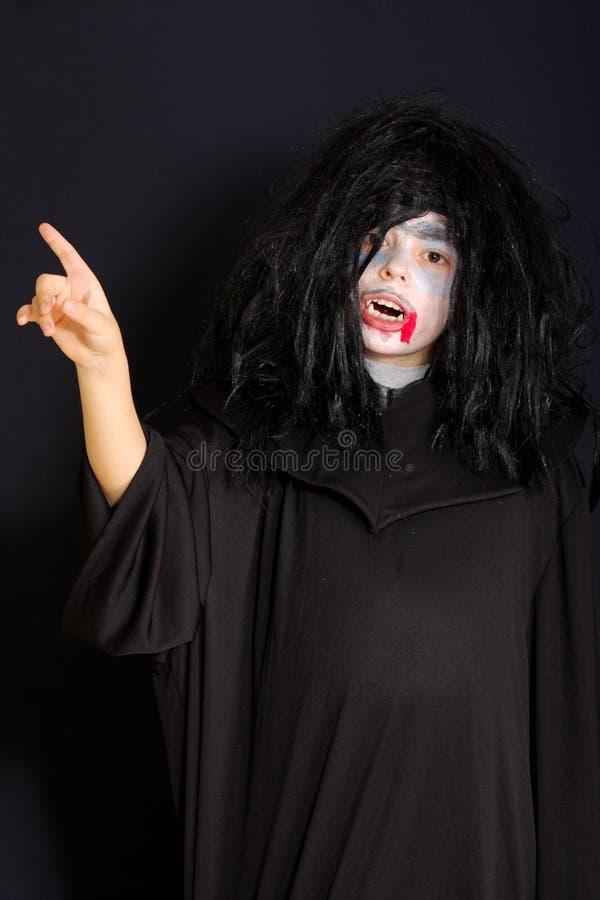 Vampiro que aponta o forefinger foto de stock royalty free