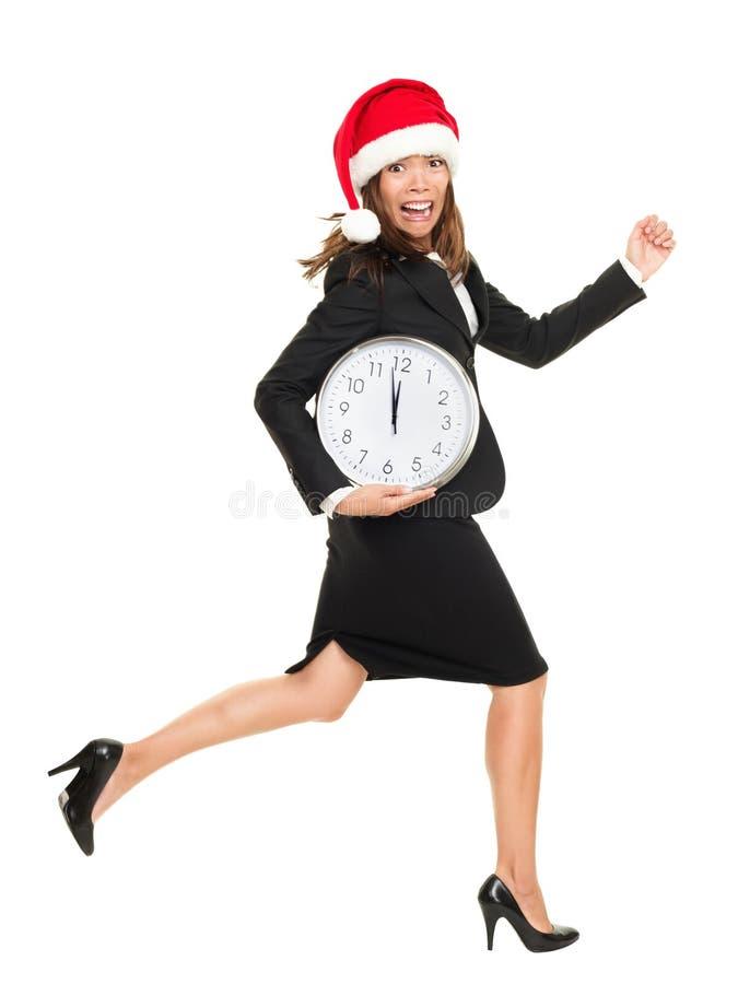 Van bedrijfs Kerstmis vrouw die tegen tijd loopt royalty-vrije stock afbeeldingen