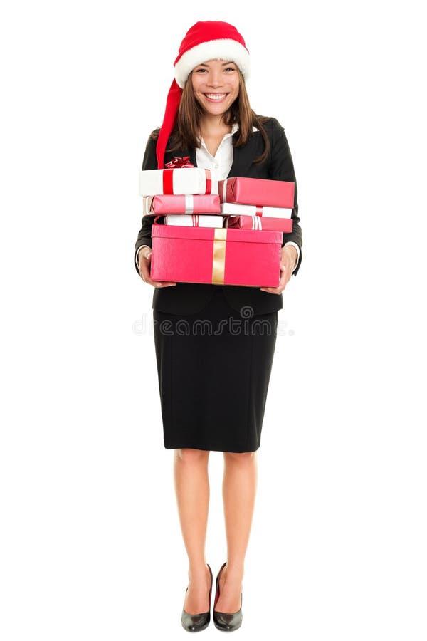 Van bedrijfs Kerstmis vrouw met santahoed en giften stock afbeeldingen