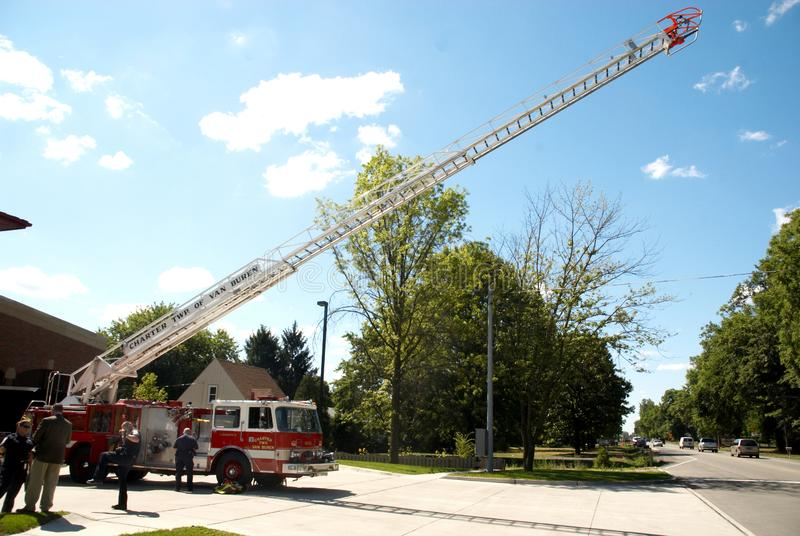 The Van Buren Fire Department in Van Buren township in Michigane. The Van Buren Fire Department`s Ladder truck fully extended royalty free stock image