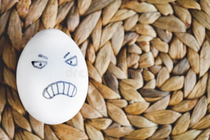 Van concepten menselijke verhoudingen en emoties eieren - woede stock afbeelding