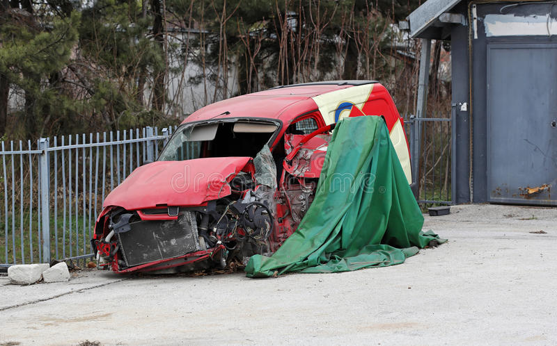 Van crush. Red van crushed in the back yard royalty free stock photos