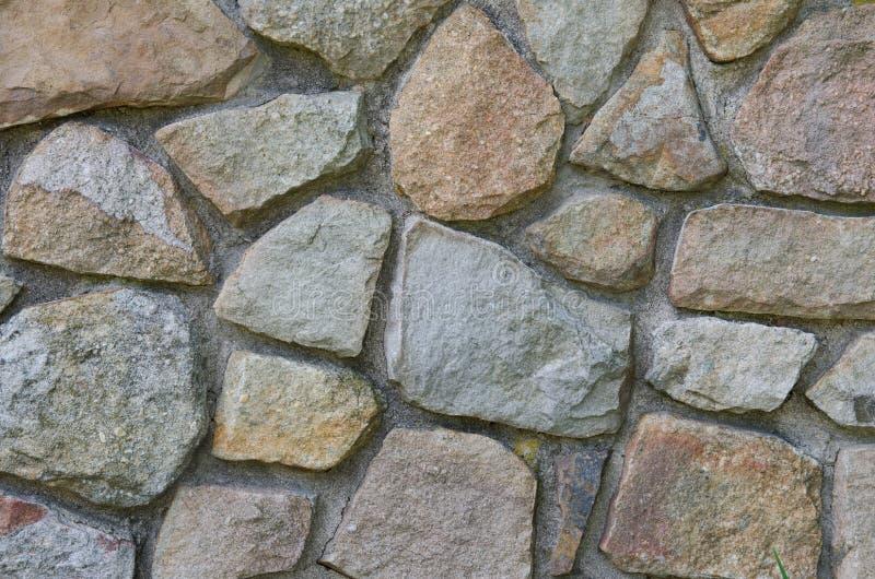 Van de achtergrond steenmuur mozaïek stock afbeeldingen