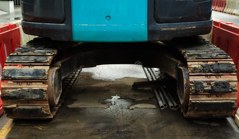 Van de de bouwwerfmachine van de spoorclose-up graaf het graafwerktuigbulldozer royalty-vrije stock foto's