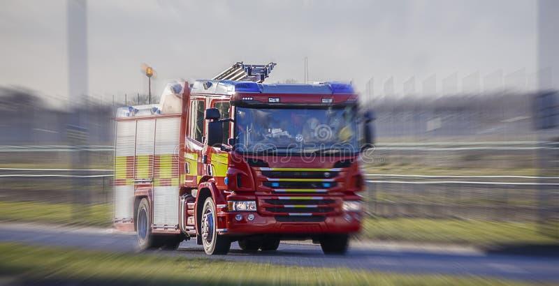 Van de brandvrachtwagen/Motor het verzenden aan een vraag stock foto's