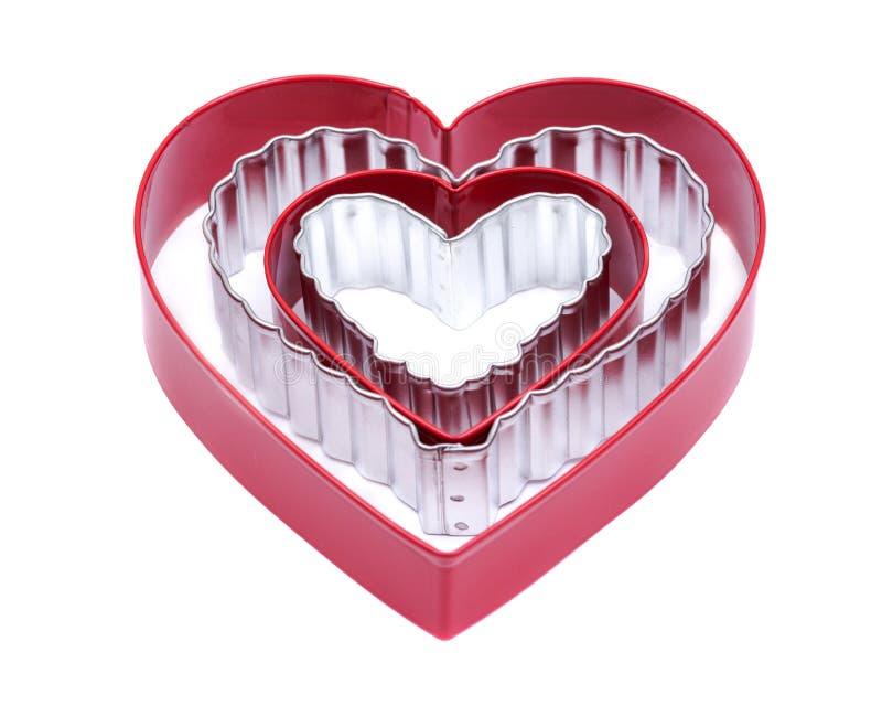Van de de cakesnijder van de hartvorm de holle plastic vorm en roestvrij staal hart-vormige giftkoekjes die vorm voor het dessert royalty-vrije stock afbeelding
