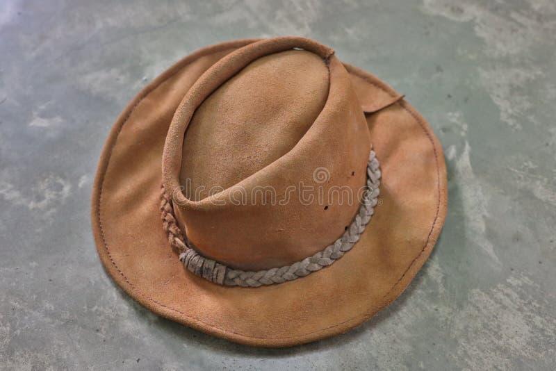 Van de de cowboyhoed van de close-upmanier achtergrond van de de stijlpastelkleur de bruine uitstekende royalty-vrije stock foto's