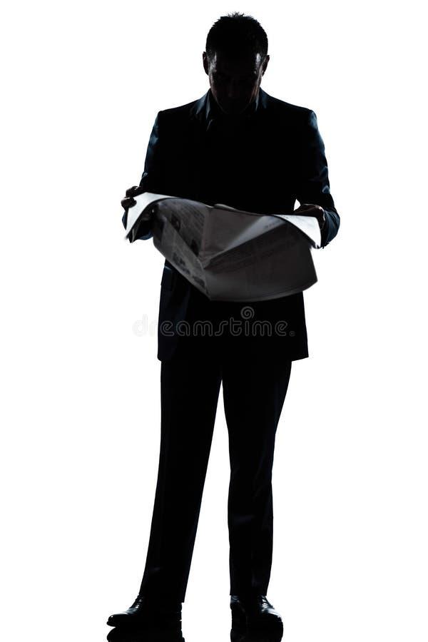 Van de de mensen volledige lengte van het silhouet de lezingskrant stock afbeeldingen