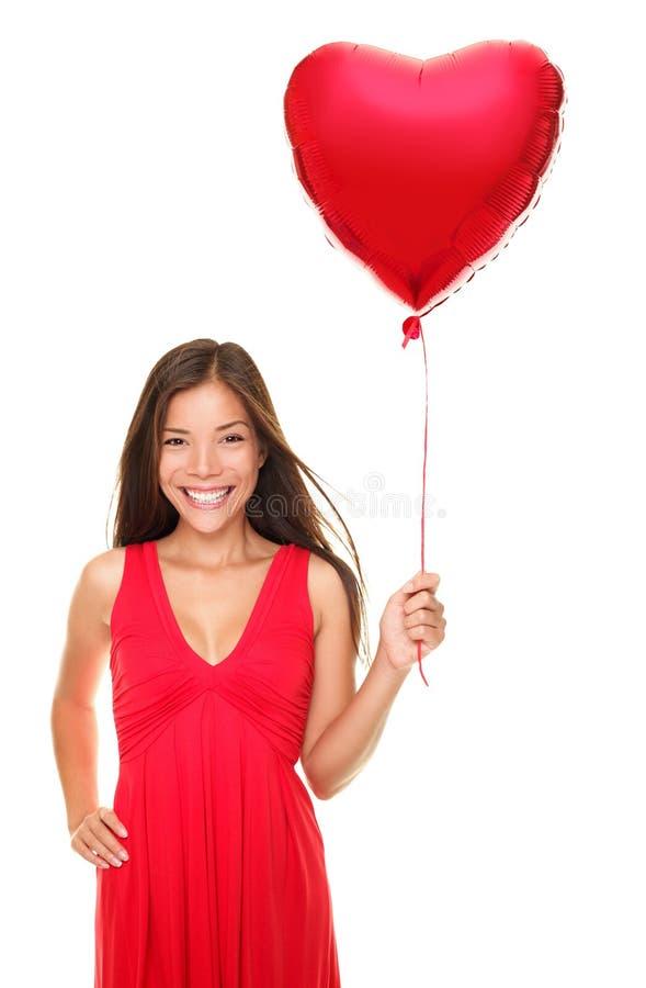 Van de de vrouwenholding van de liefde het hartballon stock afbeeldingen