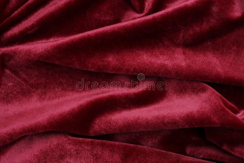 Van de fluweeltextuur rode kleur als achtergrond Kerstmis feestelijke baskground royalty-vrije stock foto