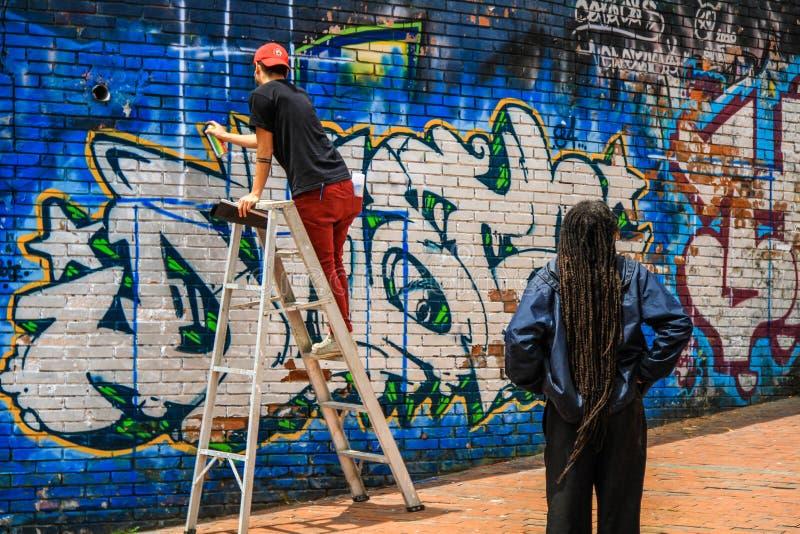 Van de graffitikunstenaars van Bogota de graffitiscène anf, Bogota, Cundinamarca, Colombia stock foto's