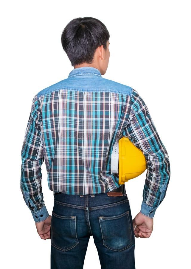 Van de de greep geel veiligheid van de zakenmaningenieur de helmplastiek en blauw van het slijtage het Gestreepte overhemd op wit stock afbeelding