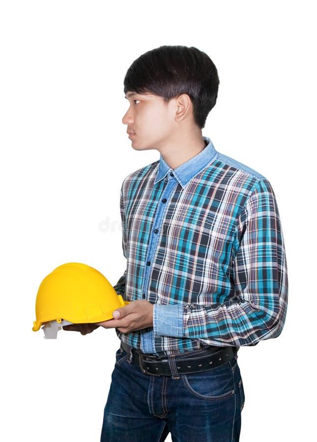 Van de de greep geel veiligheid van de zakenmaningenieur de helmplastiek en blauw van het slijtage het Gestreepte overhemd op wit stock foto
