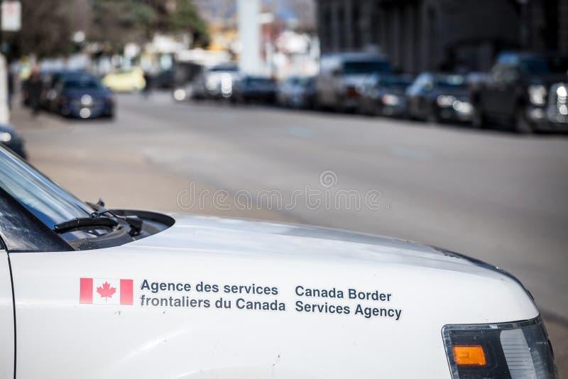 Van de de Grensdiensten van Canada het Agentschapvoertuig met zijn loog in Montreal van de binnenstad Ook genoemd geworden CBSA,  royalty-vrije stock afbeeldingen