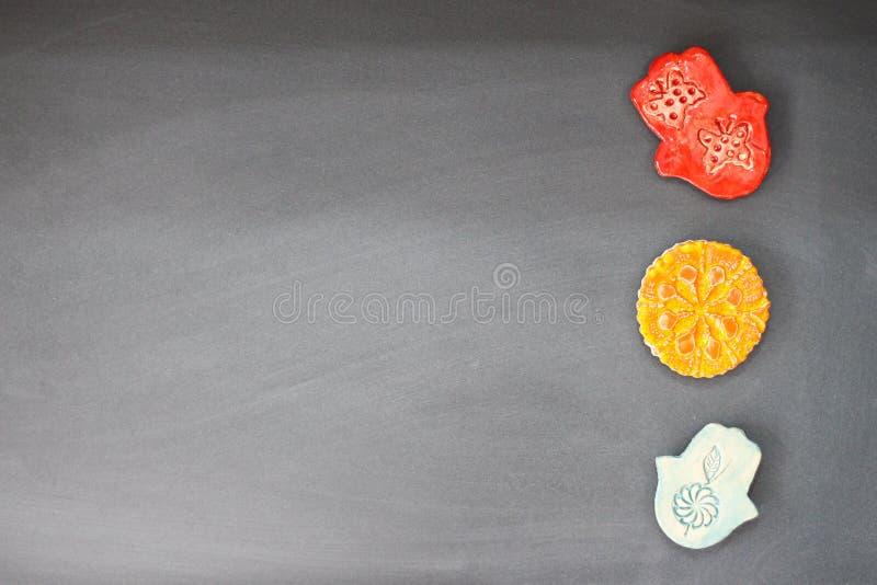 Van de Hamsahand en bloem koelkastmagneten stock fotografie