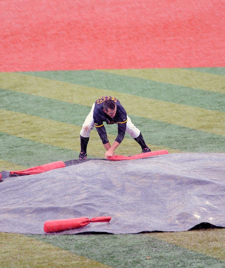 Van de het honkbalregen of hagel van de universiteit vertraging stock foto's