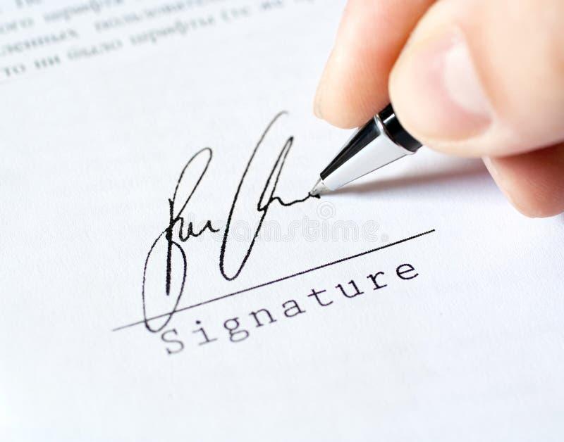 Van de het werkhand van de pen het werkhandtekening stock foto's