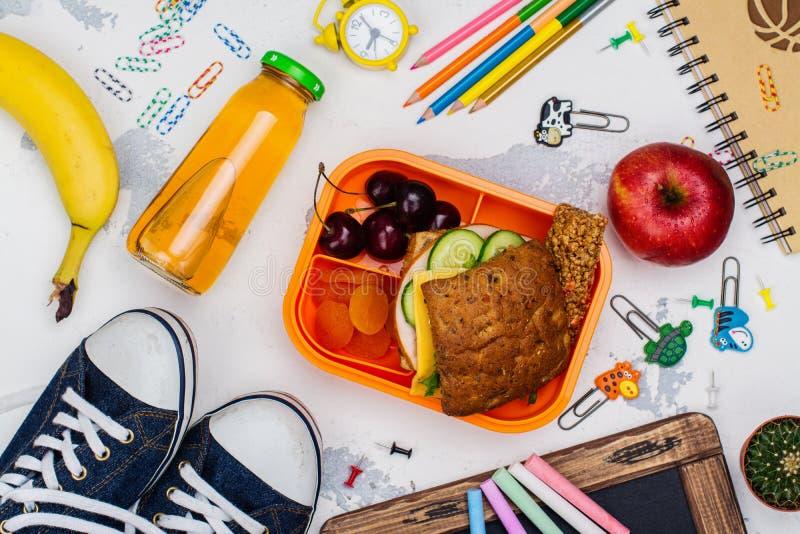 Van de lunchdoos en school levering stock foto