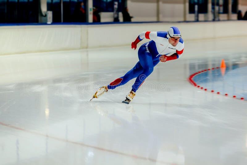 Van de de mensenatleet van het leidersras de snelheidsschaatser stock fotografie