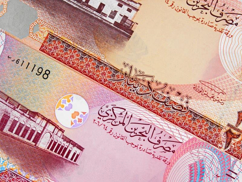 Van de de munt halve en één dinar van Bahrein het bankbiljetclose-up van 2006 macr stock foto's