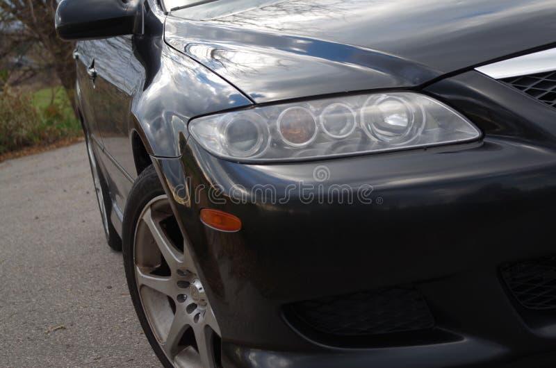Van de passagierskoplamp en Motegi 2004 van Mazda 6s (V6) voormr7 wielen stock afbeeldingen