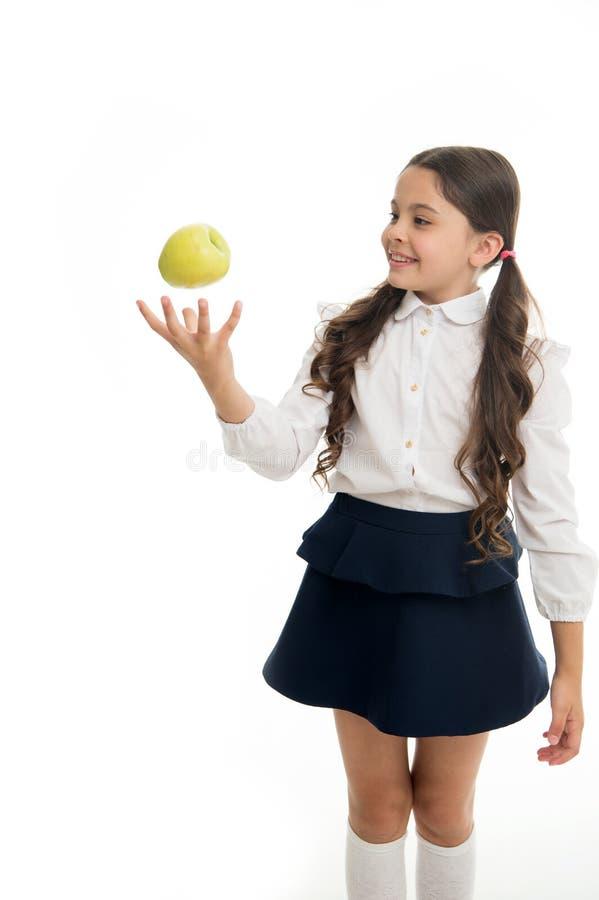 Van de school eenvormige kleren van het kindmeisje de worpappel Houdt de meisjes leuke leerling de witte achtergrond van het appe stock afbeeldingen