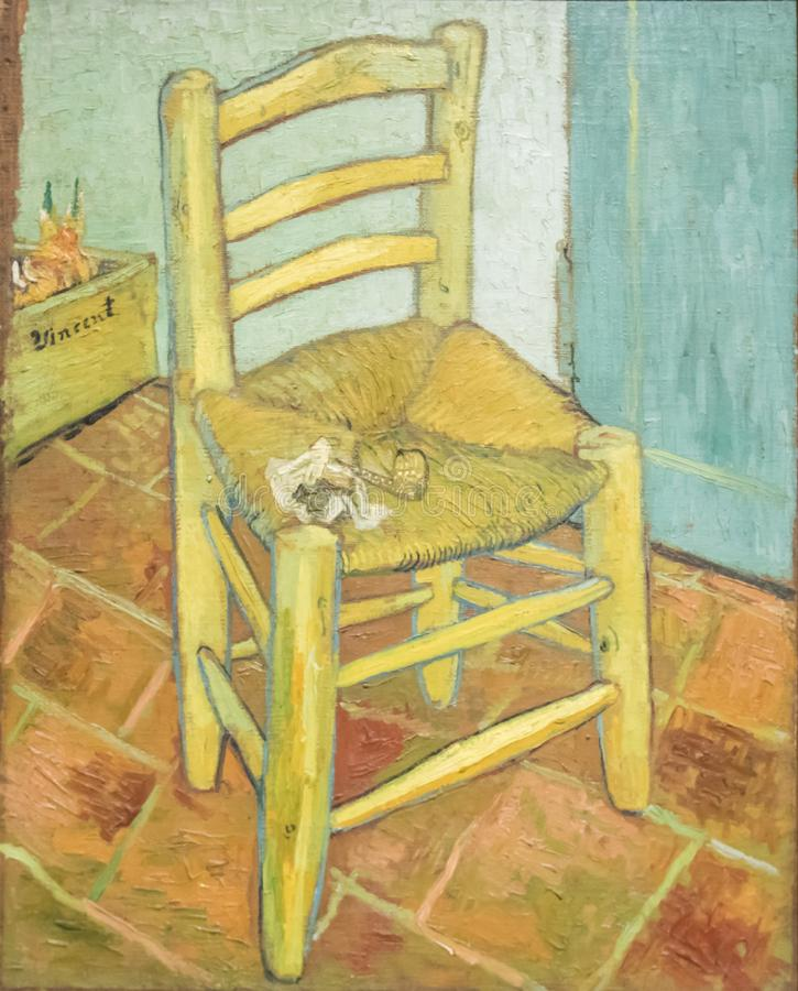 Van Gogh`s Chair. Is a painting created in 1888 by Dutch artist Vincent van Gogh. It is currently held by the National Gallery, London. The painting shows a stock photo