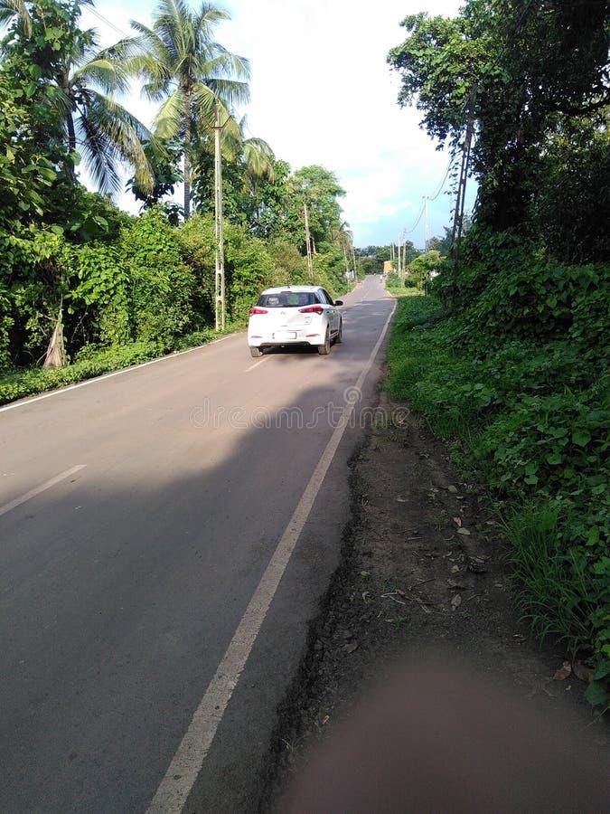 Van going through village path at evening royalty free stock photo